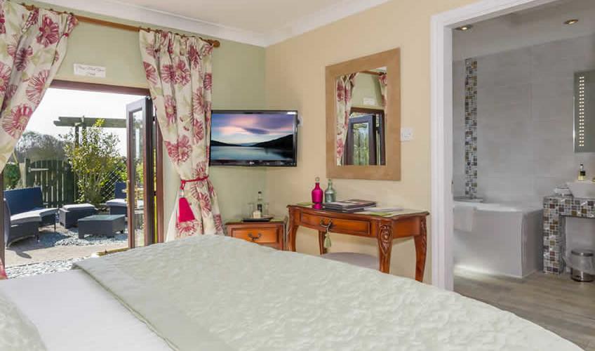 Room 14 ladies slipper bathroom and bedroom and garden viewfeatured image